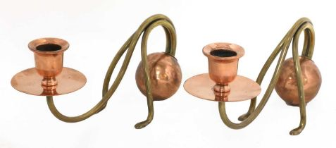 A pair of Arts and Crafts copper and brass candlesticks,