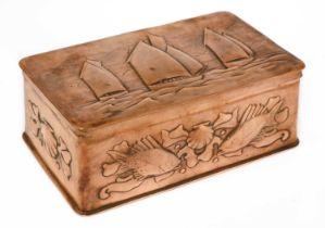 A Newlyn embossed copper casket,