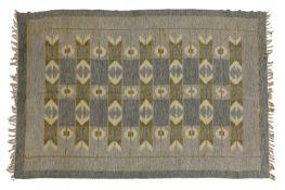 A Scandinavian flat-weave rug,