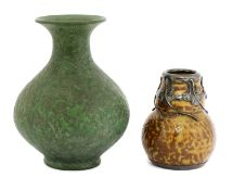 A stoneware mottled green glazed vase,