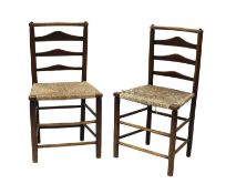 A pair of ash and elm ladderback side chairs,