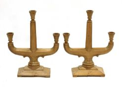 A pair of fruitwood three-branch candelabra,