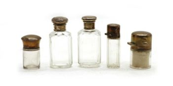 A collection of silver-mounted cut glass dressing table bottles and jars