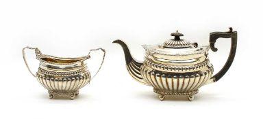 A Late Victorian silver teapot & sugar bowl (2)