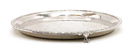 A silver circular salver