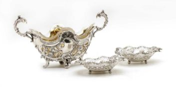 A Victorian silver and glass Rococo style dish,