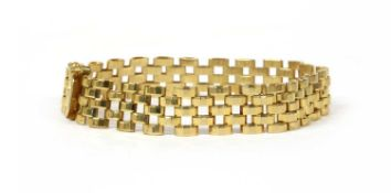 A 9ct gold three row faceted panther link bracelet,