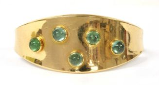 A gold gem-set torque bangle,