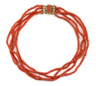 A four row uniform coral bead necklace,