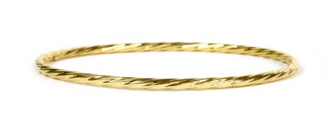 An 18ct gold hollow twisted wire bangle,