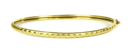 A 22ct gold oval bangle,