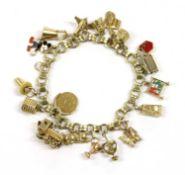 A Continental gold charm bracelet,