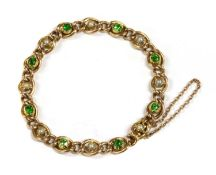 A Victorian gold demantoid garnet and split pearl curb bracelet,