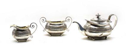 A Regency silver three piece tea service by Samuel Hennell, London,