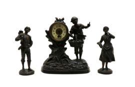 A spelter clock garniture,