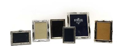 A collection of six silver and silver plated photograph frames,