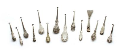 Twenty six silver handled button hooks and shoe horns