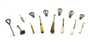 Approximately fifty shoe and glove button hooks