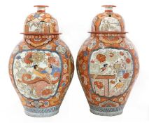 A large pair of Imari vases and covers,