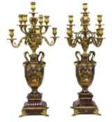 A pair of marble, gilt and patinated bronze candelabra,