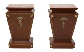 A pair of mahogany pedestals,