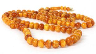A single row slightly graduated butterscotch amber prayer bead necklace,