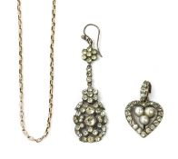 A silver paste and imitation pearl heart shaped pendant,