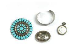 A Navajo silver turquoise brooch,