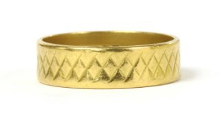 A 22ct gold diamond cut flat section wedding ring,
