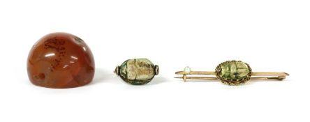 A gold scarab brooch,