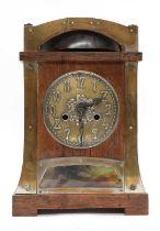 A secessionist oak mantel clock,