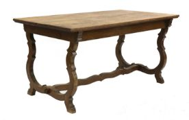 An Arts and Crafts oak refectory table,