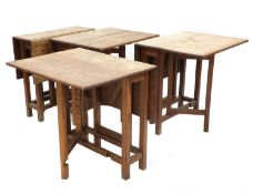 Four Cotswold oak gateleg tables,