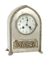 An Arts and Crafts silvered mantel clock,