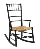 An Aesthetic ebonised child's rocking chair,