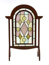 An Arts and Crafts mahogany fire screen,