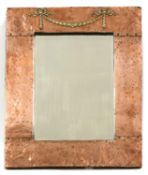 An Arts and Crafts copper mirror,