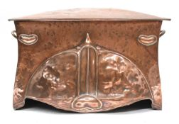 An Arts and Crafts embossed copper coal scuttle,