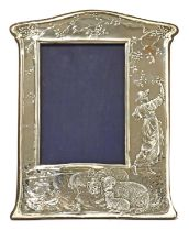 An embossed silver easel-back photograph frame,