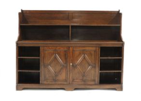 An Arts and Crafts oak bookcase,