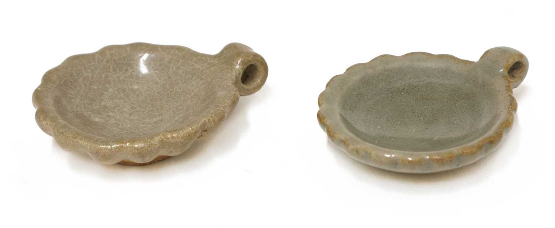 A pair of Chinese celadon-glazed bird feeders,