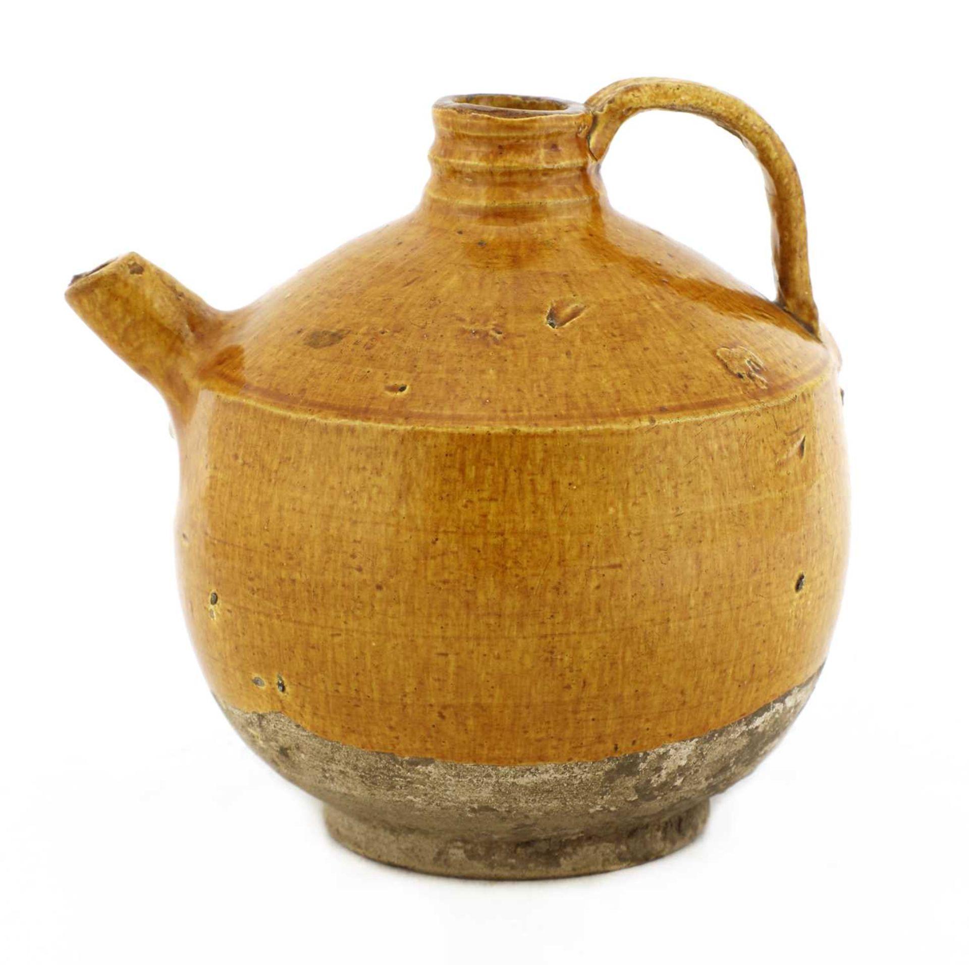 A Chinese pottery ewer,