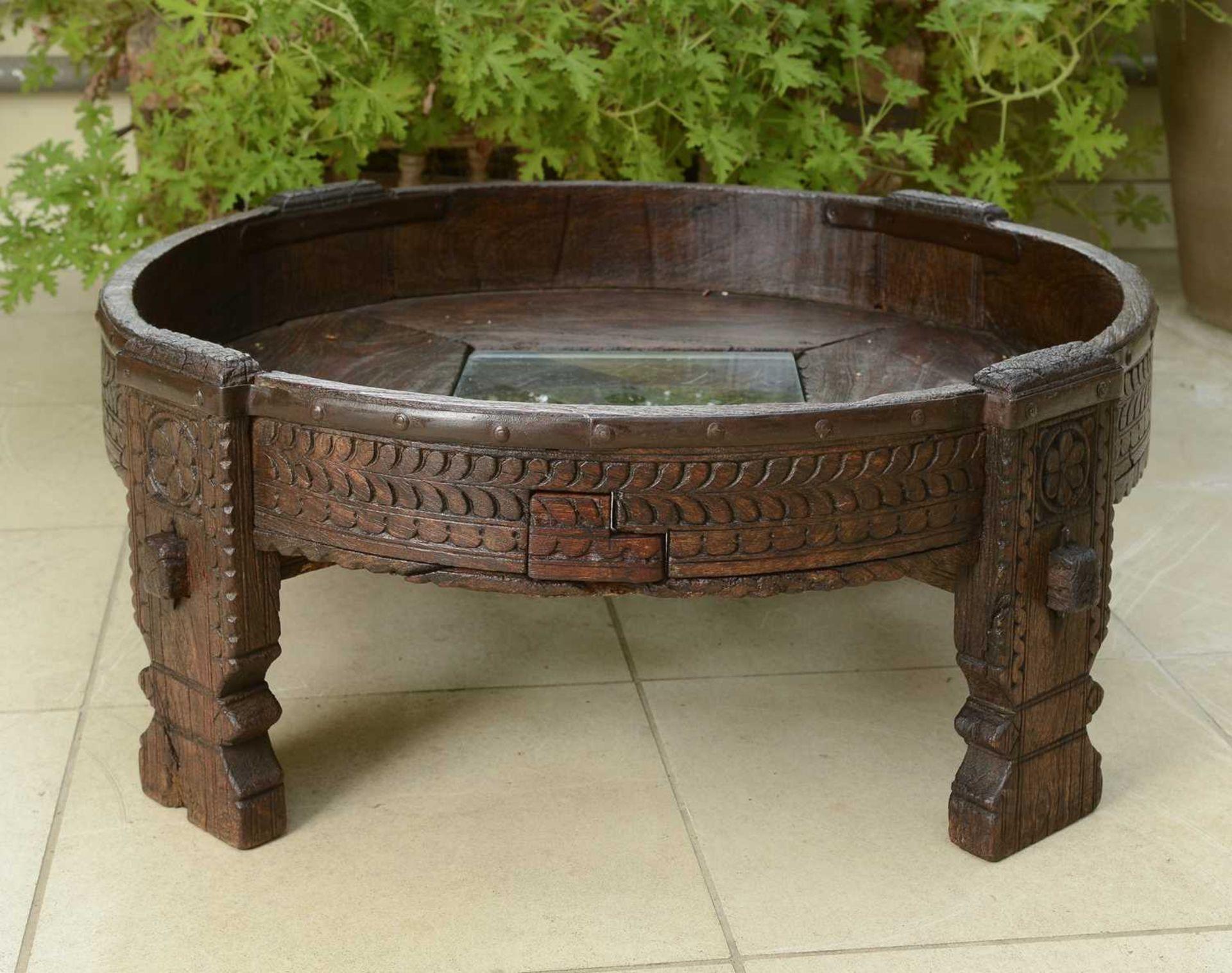 A rustic hardwood low coffee table,