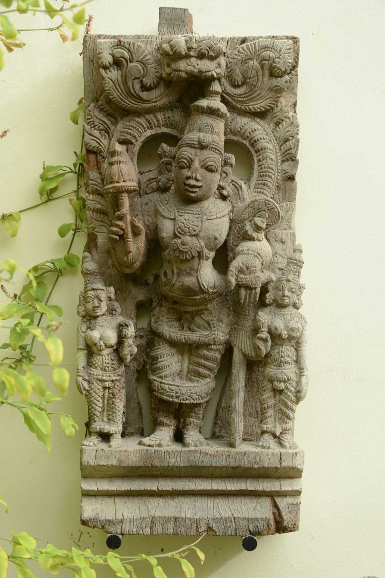 A hardwood carved panel of Vishnu,