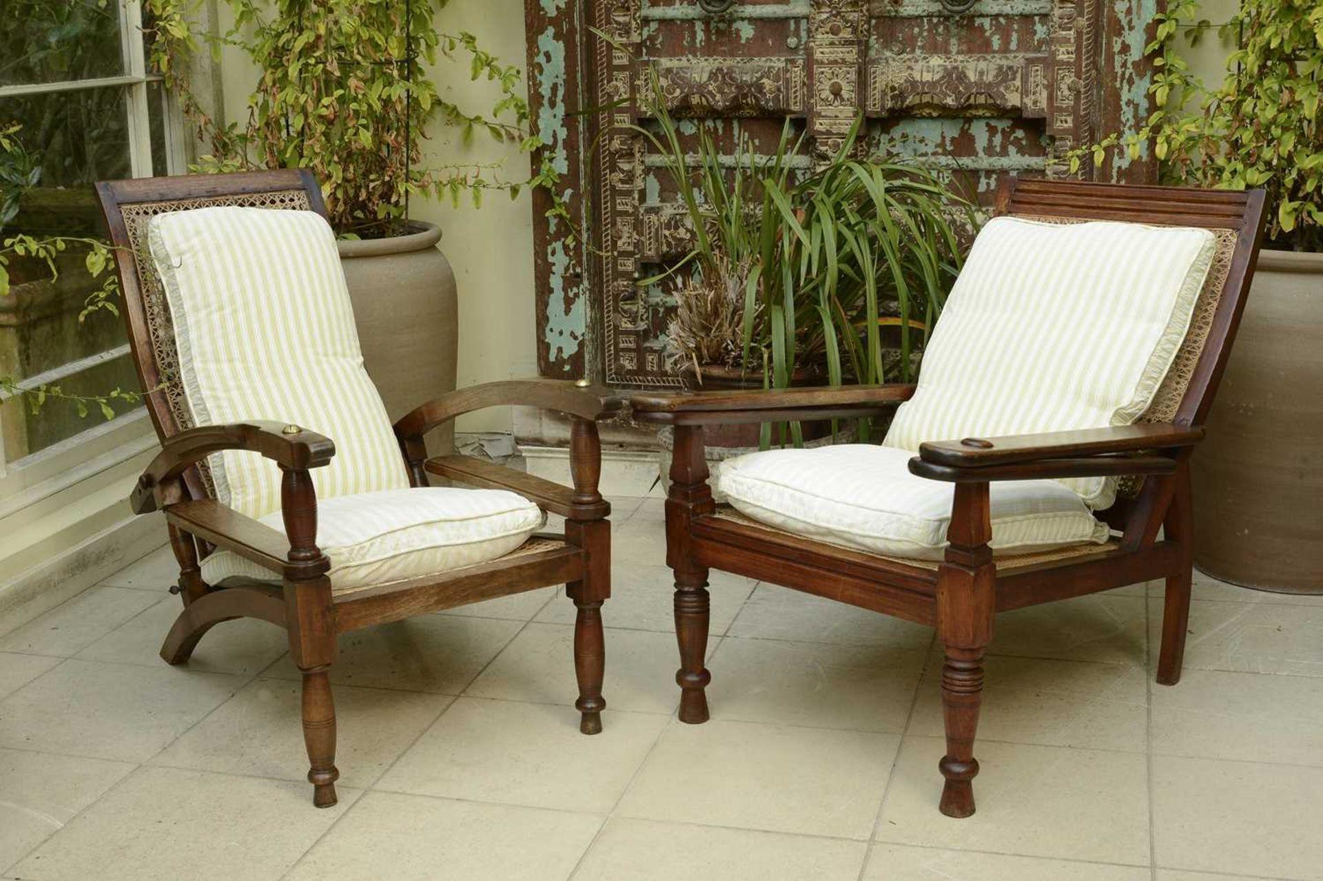 Two similar teak planter's chairs,