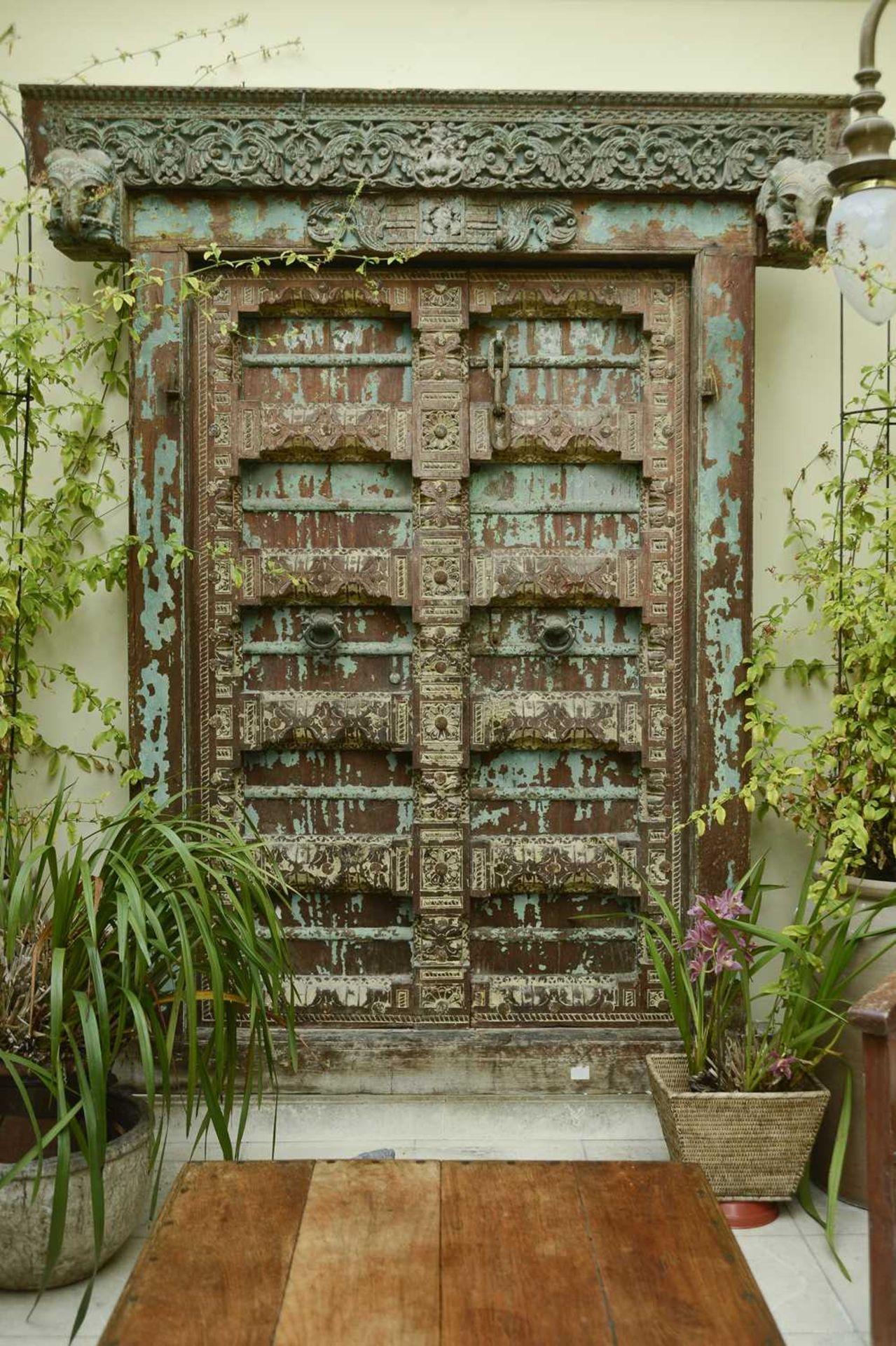 A large Indian carved hardwood door,