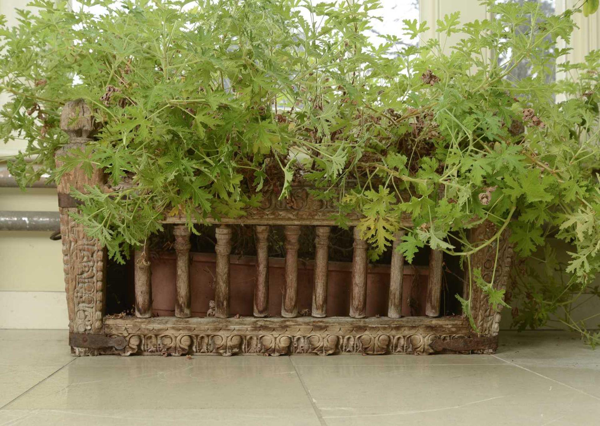A carved hardwood manger/plant stand, - Image 2 of 3