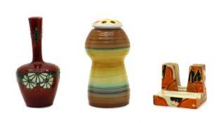 A Clarice Cliff 'Orange Chintz' pattern cigarette holder,