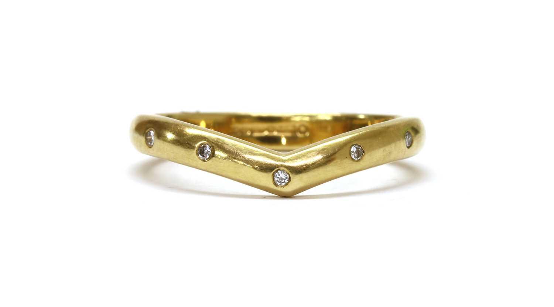 An 18ct gold diamond set wishbone ring,