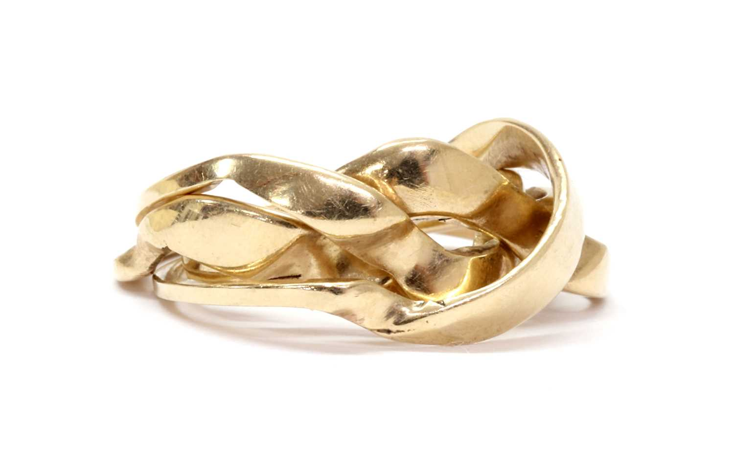 A gold four row puzzle ring,